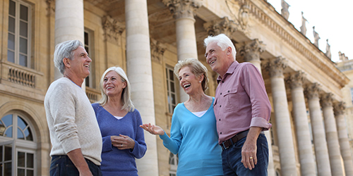 Two mature couples outside the opera in Bordeaux, France