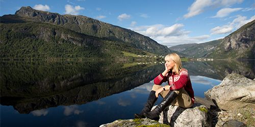 Karine Hagen sitting on boulder in fjord