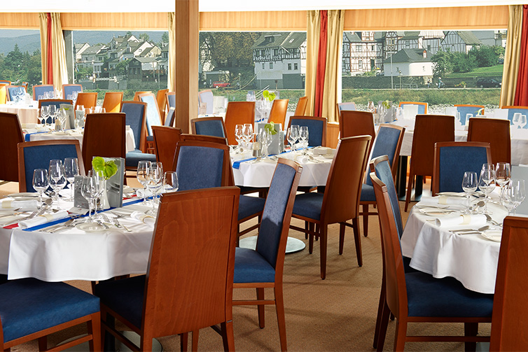 Set tables inside the restaurant of a Viking river ship