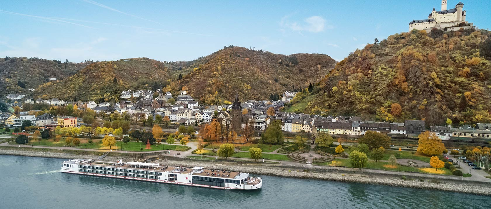 Aerial view of a Viking river ship sailing past Braubach, Germany with Marksburg Castle in the background