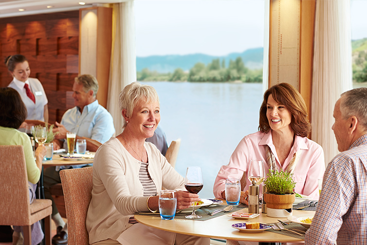 Guests drink wine in Viking Longship restaurant