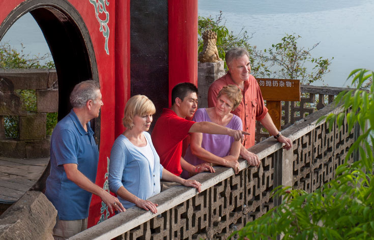 Guide teaching couples at Shibaozhai Temple, China