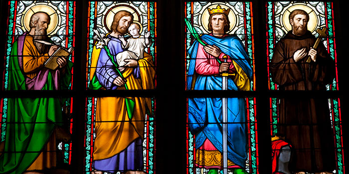 Stained glass images of St. Vitus Cathedral