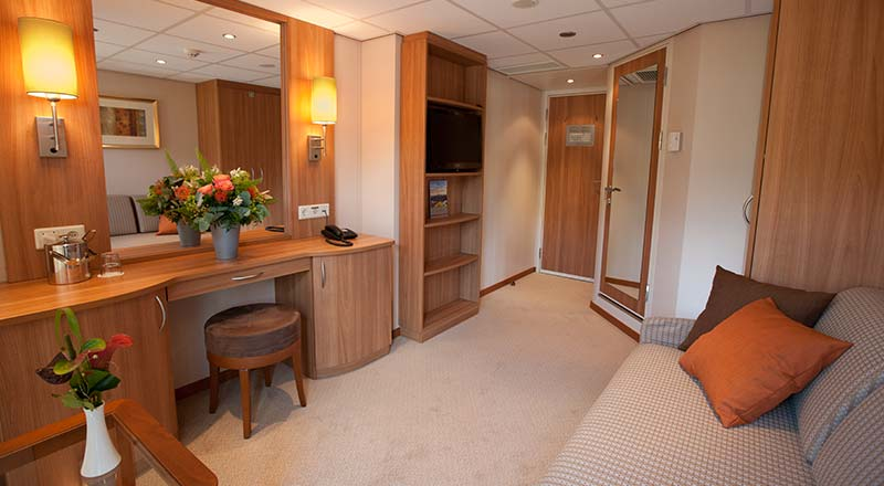 The living room of a Standard stateroom on board a Viking river ship