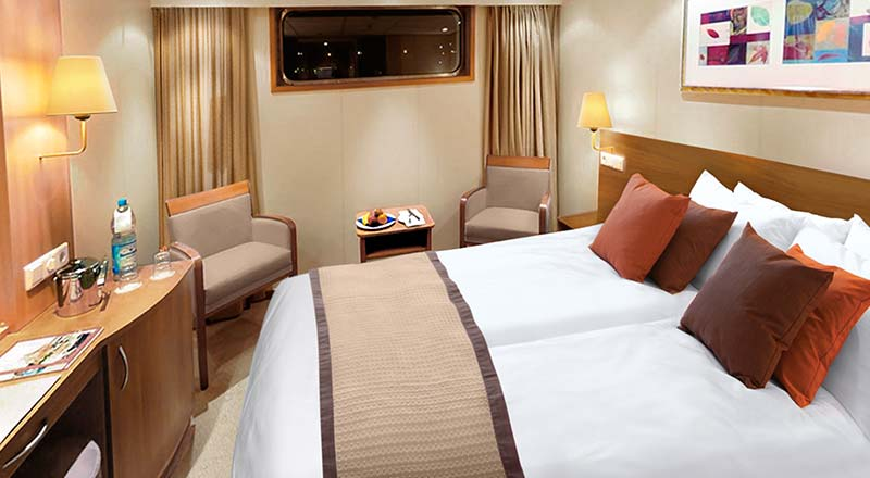Bed of a Standard stateroom on board a Viking river ship