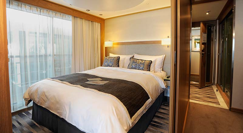 Bed inside an Explorer Suite stateroom onboard a Viking river ship