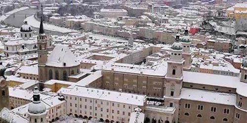 Snow covered buildings as seen from above on a Holiday Viking Cruise.