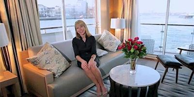 Karine Hagen sitting on a couch in the Exlorers' Lounge of a Viking river ship