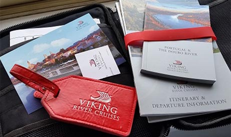 Viking luggage tag and informational cruise materials.